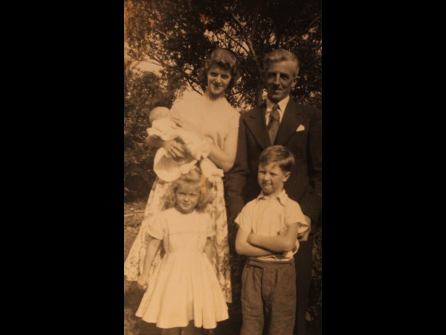 Aimee holding Dorothy and Arnold, with Linda and Tony, at Dorothy's Christening, August 1957