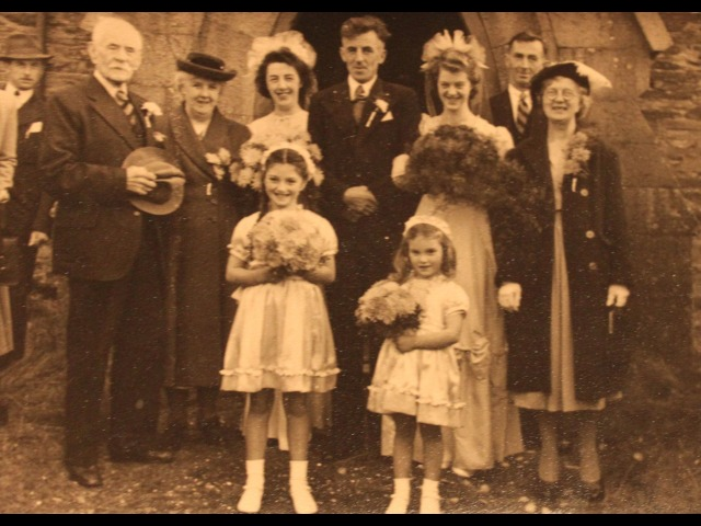 The wedding of Aimee & Arnold Corlett, 1st November 1949, Cronk-y-Voddy church,</br> Back row, left-to-right: Sam Cowell (Aimee's father), Louise Corlett (Arnold's mother), May Corlett (Arnold's sister), Arnold Corlett, Aimee Corlett (nee Cowell), Jack Corlett (Arnold's brother), Elsie Cowell (Aimee's mother).</br> Front row, left-to-right: Jean Moore and Shirley moore