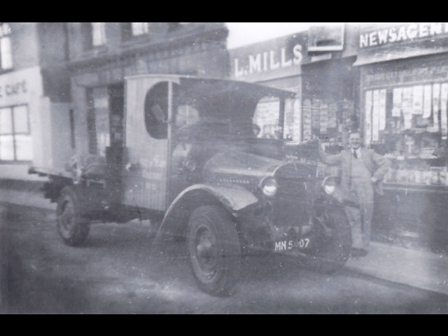 The early days outside the Dale Street premises. The car belonged to Mr Len Mills. The man in the picture is his brother, visiting from Manchester.