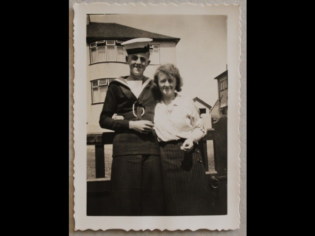 Mr Lionel Taggart aged c.15 years old with his mother outside their home in Onchan