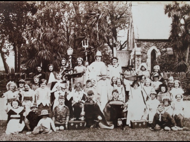 Tommy Cashen's sister, Eva, is standing in the second row from the front, second from the left.