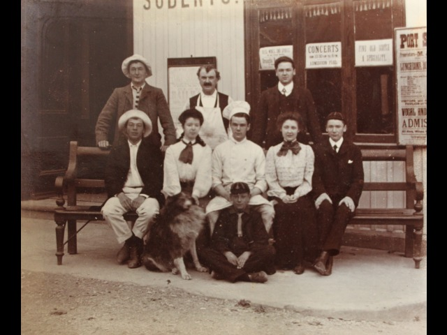 The staff of Port Soderick in front of the pavillion. Second from left is Sarah Forrester with her dog, 'Boy.'