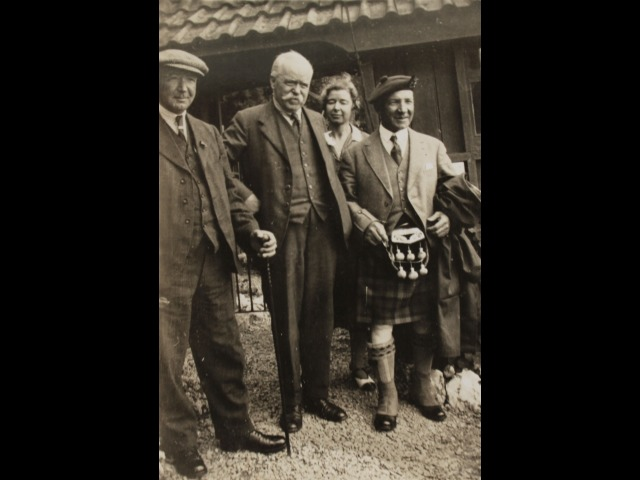 Thomas Forrester and his daughter, Sarah, are centre, with the piper employed for the summer season at Port Soderick during the 1920s.