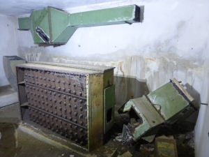 The inside of one of the bunkers today. The air filtration equipment is still largely intact.