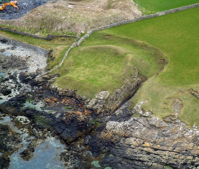 This aerial view of the site shows the gulley to the side. It is possible that the seaward side of the site has eroded over the years.
