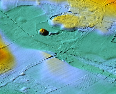 A LiDAR image of the site. The mound is clearly visible as is the remains of what might have been a causeway leading to the moat and drawbridge. LiDAR (Light Detection and Ranging) is a method of scanning the ground from aircraft using lasers. This image is by courtesy of Dave Martin from materials supplied by the mapping section of the Isle of Man Government's Department of Infrastructure (under licence ACA-1040).
