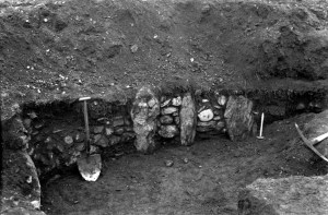 A detail from the 1912 dig showing the size of stones they found on the summit. These could have been the foundation for a structure that once stood there.