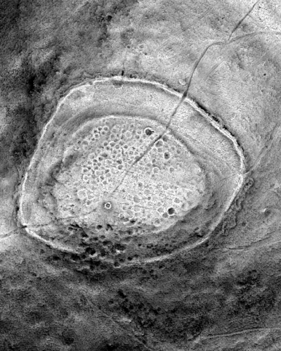 A LiDAR image of the summit of South Barrule. LiDAR (Light Detection and Ranging) is a method of scanning the ground from aircraft using lasers. This image, provided by Steve Davis of University College, Dublin, reveals numerous hut circles that were previously unknown.